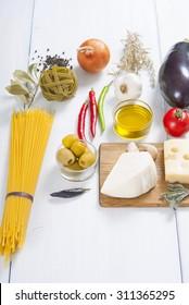 mediterranean food ingredients on white wood table
