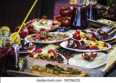 Mediterranean food plates, European cuisine, medieval fair in Spain