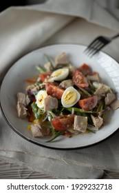 mediterranean food. Salad with vegetables, meet and eggs.