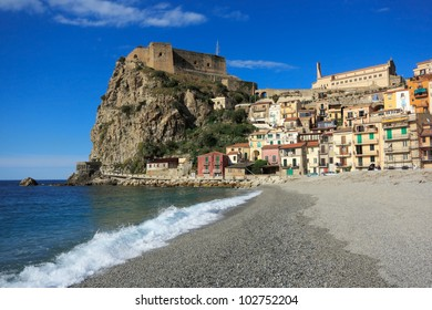 Mediterranean gravel beach and the town of Scilla, Calabria, Italy.