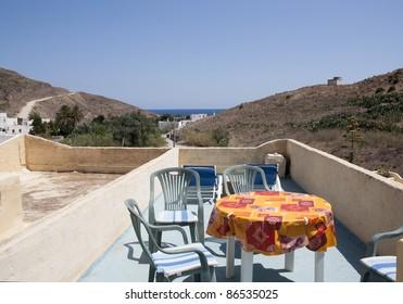 Mediterranean holidays houses, small terrace. Andalusia. Desert landscape at Cabo de Gata-Nijar Natural Park - Image taken in Las Negras village - Almeria, Spain