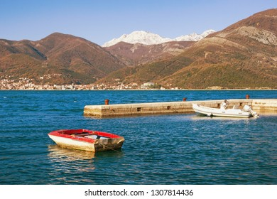 Mediterranean landscape on sunny winter day. Montenegro, Adriatic Sea, Bay of Kotor. View of snow-capped mountain of Orjen