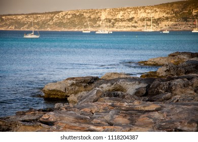 Mediterranean landscape with some boats in the background