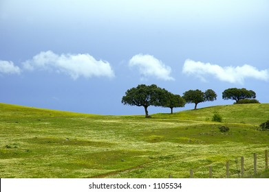 A mediterranean landscape in spring with a stormy sky