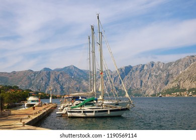 Mediterranean landscape with yachts moored at the pier. Montenegro, Adriatic Sea, Bay of Kotor