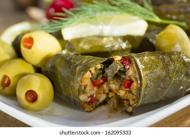 Mediterranean meal plate - grape leaves stuffed with rice.