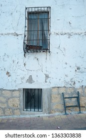Mediterranean old town facade with peeling of plaster