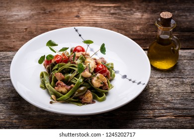 Mediterranean pasta with grilled octopus and vegetables