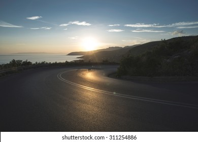 Mediterranean road on sunset. Cloudy sky