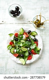 Mediterranean salad with caper berries and olives