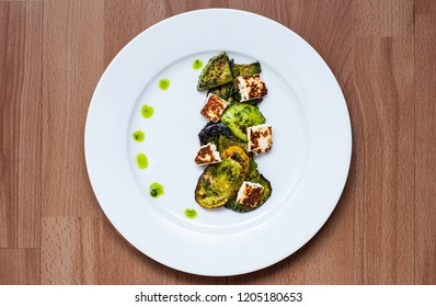 Mediterranean salat with parsley pesto and grilled manouri cheese