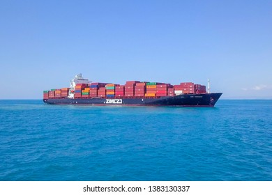 Mediterranean Sea - April 24, 2019: Aerial image of a Large ZIM container ship at sea, loaded with various container brands.