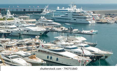 Mediterranean sea, boats and Monaco yacht club timelapse in Monte Carlo district, Monaco. Top view at sunny summer day