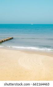 Mediterranean sea, empty beach with small peer in Tel Aviv