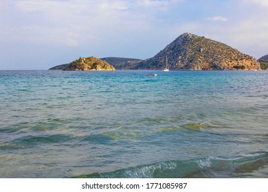 Mediterranean Sea with islands on the horizon and boat in Tolo, Peloponnese, Greece