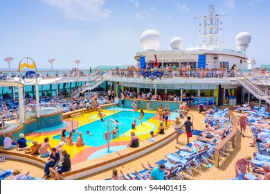 MEDITERRANEAN SEA, JUNE 17, 2016:  Passengers aboard Royal Caribbean's Brilliance of the Seas relaxing by the pool during a day at sea.