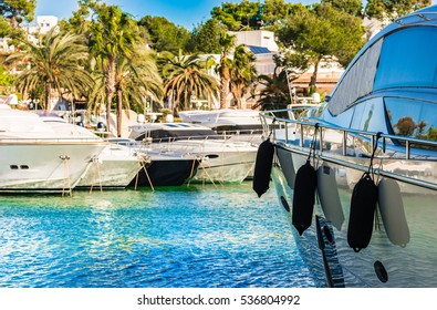 Mediterranean Sea, marina of Cala D'Or with recreational motor boats yachts, Spain Majorca harbor, Balearic islands.