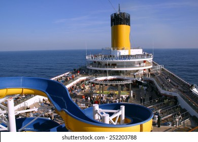 MEDITERRANEAN SEA - NOVEMBER 11: Passengers enjoy a sunny day on the deck cruise ship Costa Magica, while sailing the Mediterranean Sea on November 11, 2007.