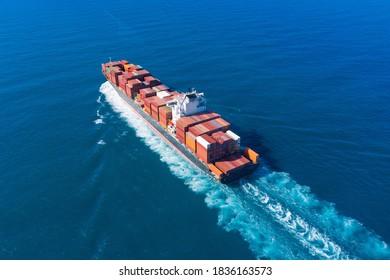 Mediterranean Sea - October 2, 2020: Zim Tarragona loaded Container ship cruising away from port, Aerial view.