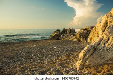 Mediterranean sea sand and stone lonely beach waterfront coast line morning scenery landscape