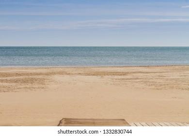 Mediterranean sea, sand and wooden walkway in Cullera, Valencia, Spain