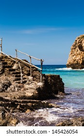 Mediterranean sea and stone stairs on Spain Mallorca island
