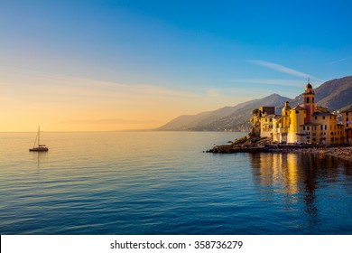 Mediterranean Sea at sunrise, small old town and yacht - Europe, Italy, Camogli