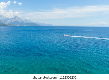 Mediterranean Sea with turquoise water and motorboad  in Kemer, Turkey.