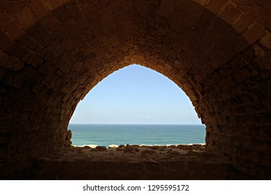 Mediterranean Sea view from an arch in the Keep of Arsuf (Apollonia) Crusader fortress, Israel. In the Battle of Arsuf Richard I of England (Lionheart) defeated the Ayyubid forces of Saladin