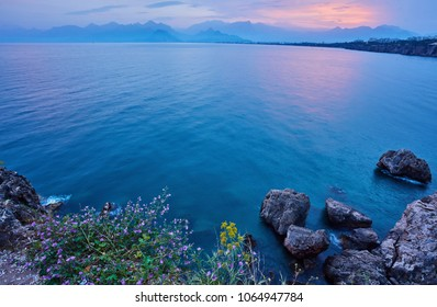 Mediterranean Sea. View of the sea from the resort town of Kemer, Antalya, Turkey. Sunset over the Taurus mountains.