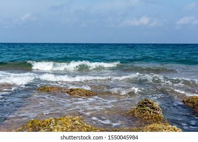 Mediterranean Sea waves over brow low rocks