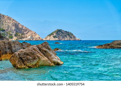 mediterranean shore with cliffs and rocks