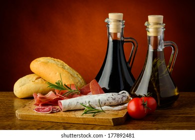 mediterranean snack with ham, salami, bread, tomatoes and olive oil