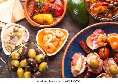 Mediterranean starters tapas on wooden table