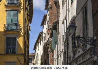 A Mediterranean street in the summer with picturesque colorful houses and a blue sky