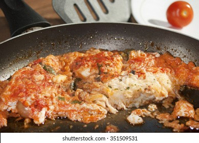mediterranean style cof fish fillet with tomato sauce capers and olives stir fried
