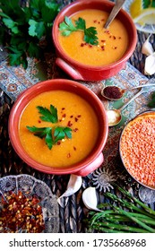 Mediterranean style colorful homemade red lentil soup in ceramic bowls