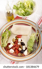 mediterranean style crepe with tomato, salad, goat cheese, green and black olive