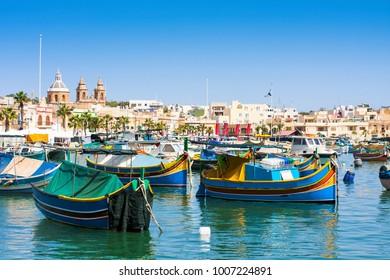 Mediterranean traditional colorful boats luzzu. Fisherman village Marsaxlokk in south east Malta.