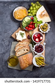 Mediterranean traditional snack with olives, pepperoni, ciabatta, olive oil,  honey, fruits, italian or greek food concept, appetizers, antipasti, top view