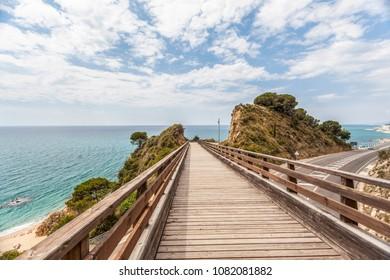 Mediterranean view, road and wooden runway close to Calella Mar,Maresme area,Catalonia.Spain.