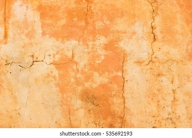 Mediterranean wall, terracotta colored background texture.