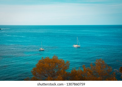 Mediterraneans scene. Turquoise crystal clear waters of Ibiza island.Two Sailing boat on the water