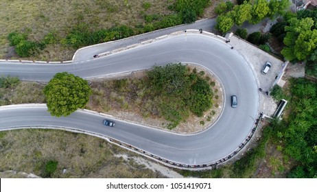 Medium altitude aerial photo hairpin turn also called hairpin bend hairpin corner named for its resemblance to hairpin bobby pin is bend in road with a very acute inner angle vehicles driving up