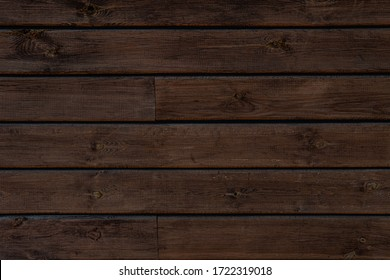 Medium brown wood texture background viewed from above. The wooden planks are stacked horizontally and have a worn look.