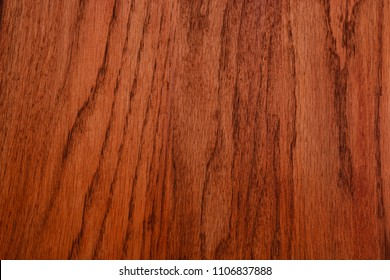 Medium color Pecan woodgrain vertical grain can be used as a seamless tileable background.