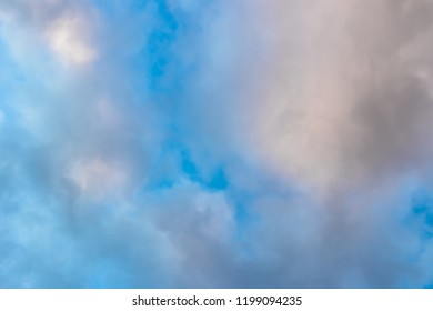 Medium dark clouds against a blue sky in an appealing pattern