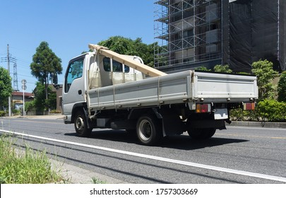 medium flatbed truck going on road