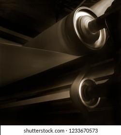 Medium format film shot. Paper reel rolling in a rotary press machine.