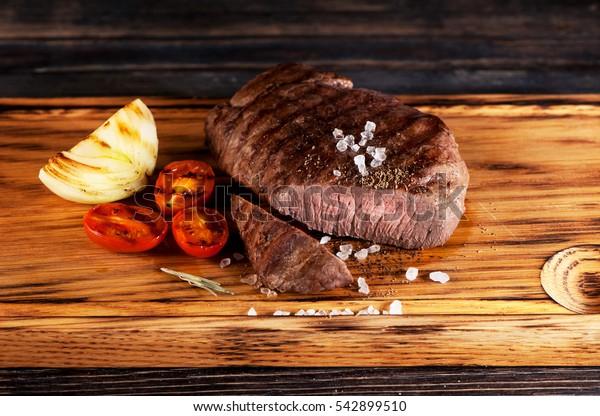medium rare grilled beef steak